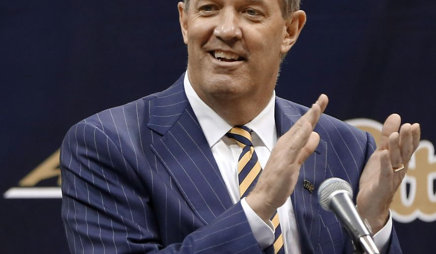 FILE - In this March 28, 2016, file photo, Kevin Stallings claps for the Pitt band as he arrives at his introductory news conference as the new head coach for the Pittsburgh basketball team, in Pittsburgh. Stallings is promising a fresher, more up-tempo approach that he hopes will lift the Panthers into the upper echelon of the hyper competitive ACC. (AP Photo/Keith Srakocic, File)
