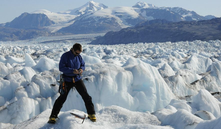 An Aug. 27, 2009 photo provided by Leigh Stearns shows University of Maine professor Gordon Hamilton, in Kangerdlugssuaq Glacier, East Greenland. Hamilton was killed Saturday, Oct. 22, 2016, when he tumbled 100 feet to his death while conducting research in Antarctica.  (Leigh Stearns via AP)