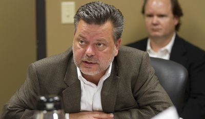 FILE - In this Oct. 23, 2012, file photo, Republican donor Andy Miller Jr., front, and brother Tracy Miller listen to proceedings at a meeting of the Tennessee Registry of Election Finance in Nashville, Tenn. State Sen. Mark Green, a leading contender for governor in 2018, says he is re-evaluating his financial ties to the Millers after they agreed in September 2016 to pay $7.8 million to settle allegations of defrauding a federal military health care program (AP Photo/Erik Schelzig)