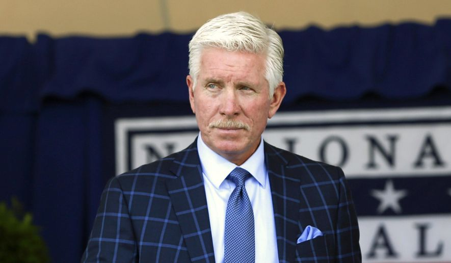 FILE - In this July 24, 2016, file photo, National Baseball Hall of Famer Mike Schmidt arrives for an induction ceremony in Cooperstown, N.Y. It is that time of year, late October, and World Series talk is in the air and Schmidt says the jinx will not affect the Chicago Cubs or the Cleveland Indians. (AP Photo/Mike Groll, File)