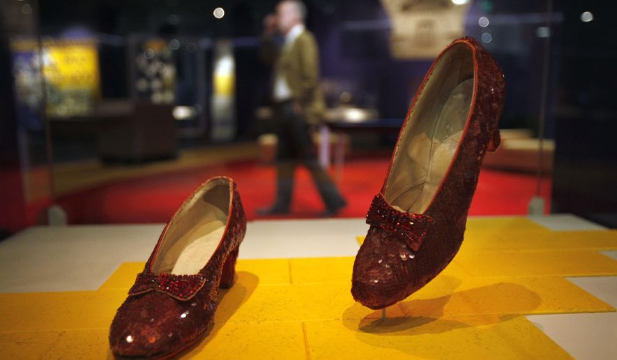"FILE - In this April 11, 2012, file photo, Dorothy's Ruby Slippers, from the ""Wizard of Oz"" are on display as part of a new exhibit, ""American Stories,"" at the Smithsonian National Museum of American History in Washington. The Smithsonian launched a Kickstarter campaign to raise $300,000 to help preserve the slippers that whisked Dorothy back to Kansas at the end of the movie. Officials said they reached their goal late Sunday, Oct. 23, 2016, thanks to more than 5,300 supporters. (AP Photo/Jacquelyn Martin, File)"