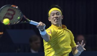 Japan's Kei Nishikori returns a ball to Serbia's Dusan Lajovic during their first round match at the Swiss Indoors tennis tournament at the St. Jakobshalle in Basel, Switzerland, on Monday, Oct. 24, 2016. (Georgios Kefalas/Keystone via AP))