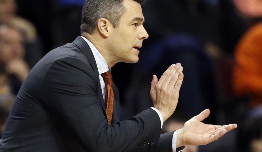 FILE - In this March 27, 2016, file photo, Virginia's head coach Tony Bennett reacts to a play during the second half of a college basketball game against Syracuse in the regional finals of the NCAA Tournament, in Chicago. Virginia  will enter this season expected to contend for the Atlantic Coast Conference championship, and for whom the way last season ended has been a motivating force for months. (AP Photo/Nam Y. Huh, File)