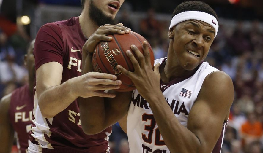 FILE - In this March 9, 2016, file photo, Florida State center Boris Bojanovsky, left, and Virginia Tech forward Zach LeDay (32) struggle for a rebound during the first half of an NCAA college basketball game in the Atlantic Coast Conference men's tournament, in Washington. The Hokies (20-15, 10-8 Atlantic Coast Conference) were the surprise of the ACC last season. They beat two teams ranked in the top 10, and closed the regular season with six consecutive victories in ACC play (AP Photo/Steve Helber, File)