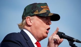 Tea partiers are casting their lot with Republican presidential candidate Donald Trump, even though analysts say his fiscal plan will explode the deficit. (Associated Press)