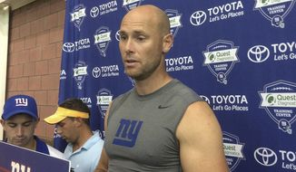 FILE - In this Aug. 18, 2016, file photo, New York Giants' Josh Brown speaks with reporters at NFL football teams training camp in East Rutherford, N.J.  Brown has issued a statement in which he admits abusing his former wife but he insists he never hit her. Brown issued the statement to ESPN on Tuesday, Oct. 25, 2016. Giants spokesman Pat Hanlon confirmed that the statement was from Brown, who was placed on the NFL commissioner's exempt list last week after authorities released emails and personal journals in which Brown admits to abusing his former wife. (AP Photo/Tom Canavan, File)