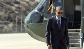 President Barack Obama walks from Marine One toward Air Force One at Los Angeles International Airport, Tuesday, Oct. 25, 2016. Obama is returning to Washington after spending a few days in Nevada and California campaigning for Democratic presidential candidate Hillary Clinton. (AP Photo/Susan Walsh)