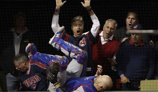 Chicago Cubs catcher David Ross class after catching a pop fly by Cleveland Indians' Lonnie Chisenhall during the first inning of Game 1 of the Major League Baseball World Series Tuesday, Oct. 25, 2016, in Cleveland. (AP Photo/David J. Phillip)