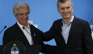 Uruguayan President Tabare Vazquez, left, and Argentina's President Mauricio Macri, embrace after a joint press conference at the presidential residence in Olivos, a northern suburb of Buenos Aires, Argentina, Monday, Oct. 24, 2016. (AP Photo/Natacha Pisarenko)