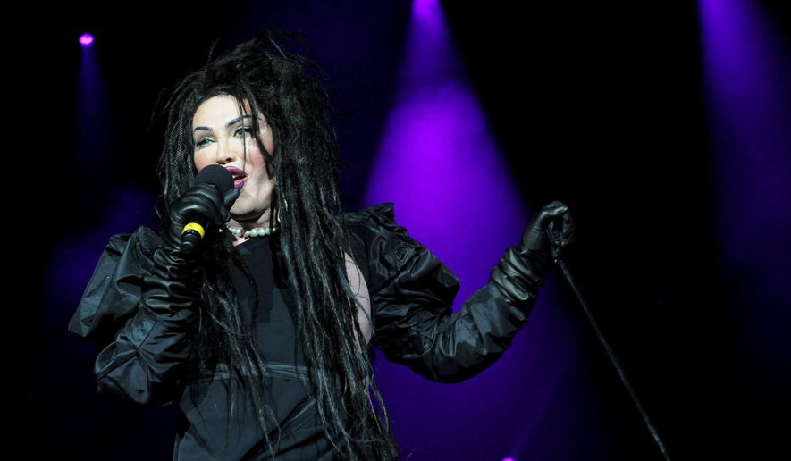 FILE - In this file photo dated Dec. 21, 2012, showing singer of the band Dead or Alive, Pete Burns in concert in London.  Burns died on Sunday Oct. 23, 2016, after suffering a cardiac arrest, according to a statement from his management.  The Dead or Alive band gained some chart success and known for his non-conformist style, Pete Burns was considered a pop icon. (Ian West / PA FILE via AP)