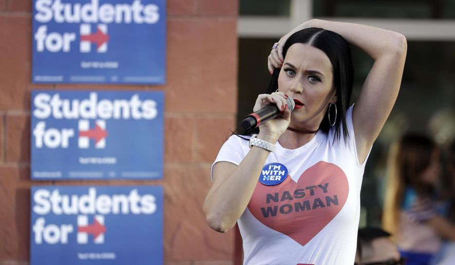 FILE - In this Oct. 22, 2016 file photo, singer Katy Perry speaks at a rally in support of Democratic presidential nominee Hillary Clinton, in Las Vegas. With Election Day nearing, a massive celebrity strike force is fanning out for Clinton, who is leading Donald Trump in most polls. (AP Photo/John Locher, File)