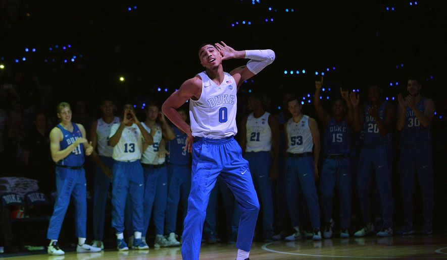Duke freshman Jayson Tatum acknowledges the crowd during the school's annual college basketball Countdown to Craziness event Saturday Oct. 22 2016, in Durham, N.C. (Bernard Thomas/The Herald-Sun via AP)