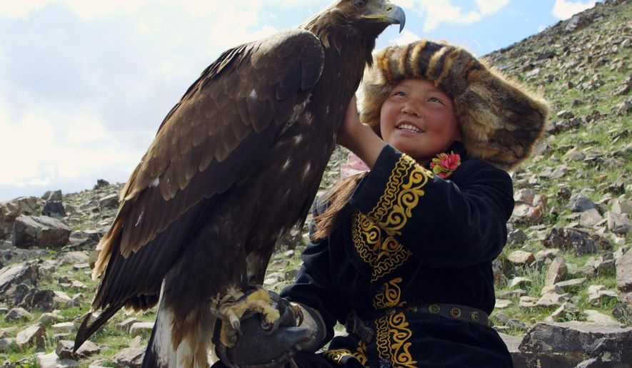 "This image released by Sony Pictures Classics shows Aisholpan in a scene from ""The Eagle Huntress,"" a documentary about a 13-year-old girl who trains to become an eagle hunter. (Sony Pictures Classics via AP)"