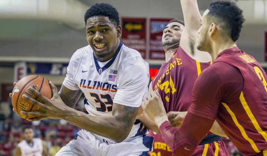 FILE - In this Nov. 28, 2015, file photo, Illinois center Mike Thorne, Jr. tries to take a shot against Iowa State's Abdel Nader, right, and George Niang during an NCAA college basketball game in Niceville, Fla. There aren't a lot of new faces on this season's Illinois team, but after a season of injuries and off-court troubles the Illini who will soon take the court will be like a whole new squad. Point guard Tracy Abrams is back after two years away with injuries, and the return of big-man Mike Thorne Jr. means Illinois, for once, has depth at center. (AP Photo/Mark Wallheiser)