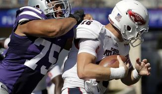 FILE - In this Sept. 17, 2016, file photo, Florida Atlantic quarterback Jason Driskel (16) is sacked by Kansas State defensive end Jordan Willis (75) during the first half of an NCAA college football game, in Manhattan, Kan. Perhaps the reason that Willis has been so successful is that his own standard is quite high. And in that respect, he walks lock-step with his hard-to-please coach. (AP Photo/Charlie Riedel, File)