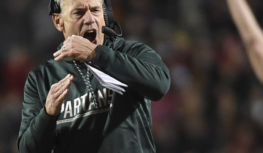 FILE - In this Oct. 22, 2016, file photo, Michigan State's Mark Dantonio calls for a timeout against Maryland in the first half of an NCAA college football game, in College Park, Md. Michigan State used to be at its best at the end of games, making plays on both sides of the ball and on special teams to win in the closing minutes or seconds. This year, the Spartans have been perhaps the worst team in major college football in the fourth quarter.  (AP Photo/Gail Burton, File)