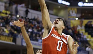 FILE - In this March 10, 2016, file photo, Nebraska's Tai Webster (0) shoots against Wisconsin's Jordan Hill (11) in the first half of an NCAA college basketball game at the Big Ten Conference tournament, in Indianapolis. Nebraska is left with only one double-digit scorer in senior Tai Webster, a promising sophomore class and a cast of newcomers that will have a lot of opportunity to play. (AP Photo/Michael Conroy, File)
