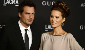 FILE - In this Nov. 1, 2014 file photo, director Len Wiseman, left, and actress Kate Beckinsale arrive at the LACMA Art + Film Gala in Los Angeles. Los Angeles court records show that Wiseman filed for divorce from Beckinsale on Friday, Oct. 21, 2016, citing irreconcilable differences. The couple have been married for 12 years. (Photo by Jordan Strauss/Invision/AP, File)