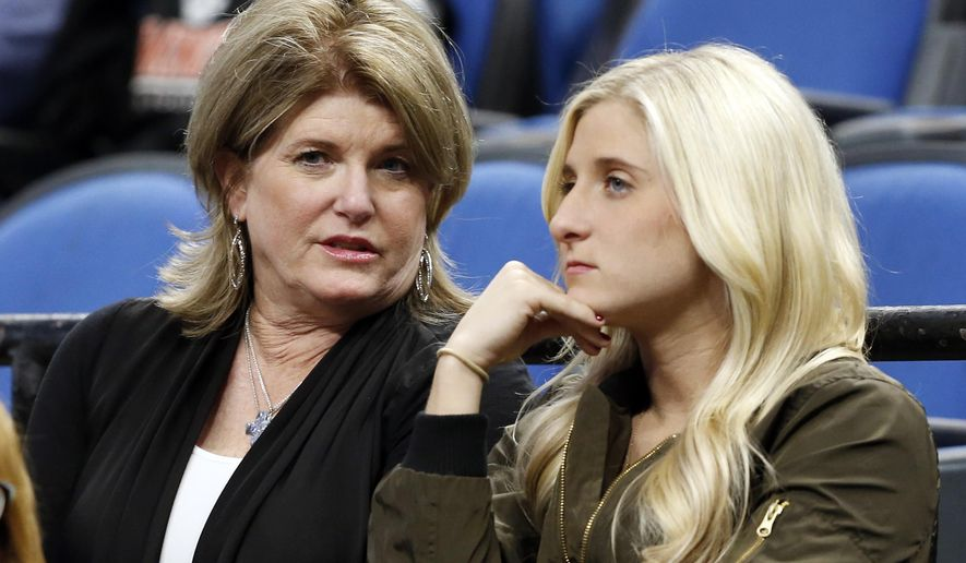 In this Oct. 21, 2016 photo, Debbie Saunders, left, and daughter Kim chat before the Minnesota Timberwolves NBA basketball game against the Charlotte Hornets in Minneapolis. It would have been easy for the Saunders family to walk away after late head coach Flip Saunders passed away last year. Instead, a year after he died, they have remained around the organization to try to help carry his legacy forward. Widow Debbie bought seats just behind the Timberwolves bench, daughter Rachel works in the Wolves front office and son Ryan is coaching with Tom Thibodeau as they try to build a winner in Minnesota. (AP Photo/Jim Mone)