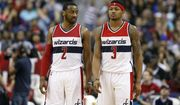 In this photo taken March 25, 2016, Washington Wizards guard John Wall (2) and Washington Wizards guard Bradley Beal (3) stand on the court during an NBA basketball game against the Minnesota Timberwolves, in Washington. With only one ball on the court at any given time, Wall and Beal know they have to share it. Wall and Beal have to share the ball on last-second shots and the limelight in the backcourt as the Washington Wizards are trying to get back to the playoffs. Wall is healthy again after having surgery on each knee, and Beal is fresh off signing a $128 million, five-year contract that ranked among the richest in the NBA this offseason.  (AP Photo/Alex Brandon)