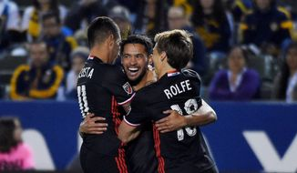 D.C. United playmaker Luciano Acosta has thrived in a new formation while veteran midfielder Lamar Neagle (center) has developed into a lethal presence off the bench. (Associated Press)