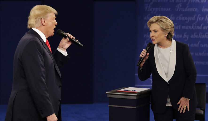 Republican presidential nominee Donald Trump and Democratic presidential nominee Hillary Clinton speak during the second presidential debate at Washington University in St. Louis. (AP Photo/John Locher, File)