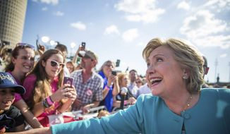"Democratic presidential nominee Hillary Clinton greets supporters following a ""Get out the vote,"" rally at Curtis Hixon Waterfront Park, Wednesday, Oct. 26, 2016 in downtown Tampa, Fla. (Loren Elliot/Tampa Bay Times via AP)"