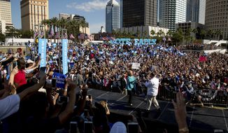 Democratic presidential candidate Hillary Clinton, center left, greets Chef Jose Andres, right, as she arrives to speak at a rally at Curtis Hixon Waterfront Park in Tampa, Wednesday, Oct. 26, 2016. (AP Photo/Andrew Harnik)