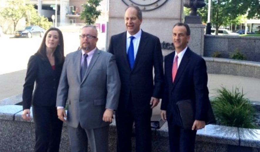 Iowa Pastor Michael Demastus (2nd from left) with lawyers from Alliance Defending Freedom. Image courtesy of the Iowa Family Leader.