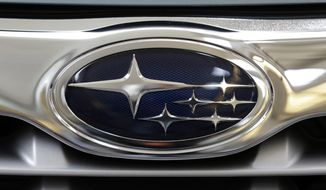 This Feb. 14, 2013, file photo shows a Subaru logo on the grill of a Subaru automobile at the Pittsburgh Auto Show in Pittsburgh. Subaru announced Wednesday, Oct. 26, 2016, the company is recalling more than 100,000 of its top-selling models in the U.S. because a turbocharger air pump can run continuously, overheat and could cause fires. (AP Photo/Gene J. Puskar, File)