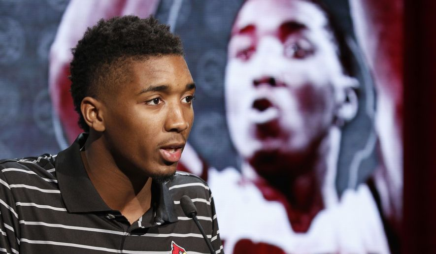 Louisville NCAA college basketball player Donovan Mitchell answers a question during the Atlantic Coast Conference media day in Charlotte, N.C., Wednesday, Oct., 26, 2016. (AP Photo/Bob Leverone)
