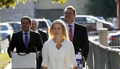 "In this Oct. 19, 2016 file photo, Gov. Chris Christie's former Deputy Chief of Staff, Bridget Kelly, center, arrives at Martin Luther King Jr. Courthouse in Newark, N.J., with her attorneys Michael Critchley Jr., right, and Michael Critchley, back second left. Kelly talked to Christie about the September 2013 Fort Lee lane closures twice while they were underway, including once in which she passed along that the city's mayor, Mark Sokolich, had asked whether the lanes were closed for ""government retribution."" (AP Photo/Mel Evans, File)"