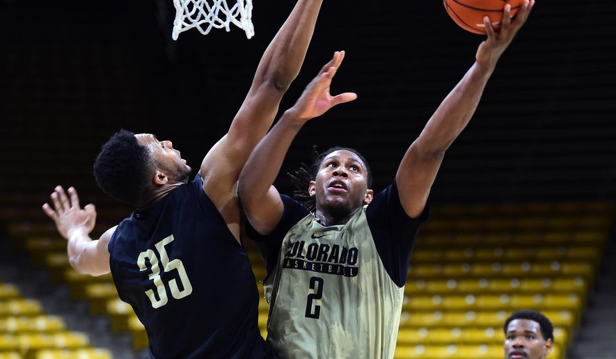 University of Colorado forward, Xavier Johnson, (2) goes to the basket on Dallas Walton (35) during basketball media day, Tuesday, Oct. 25, 2016, in Boulder, Colo. (Cliff Grassmick/Daily Camera via AP)