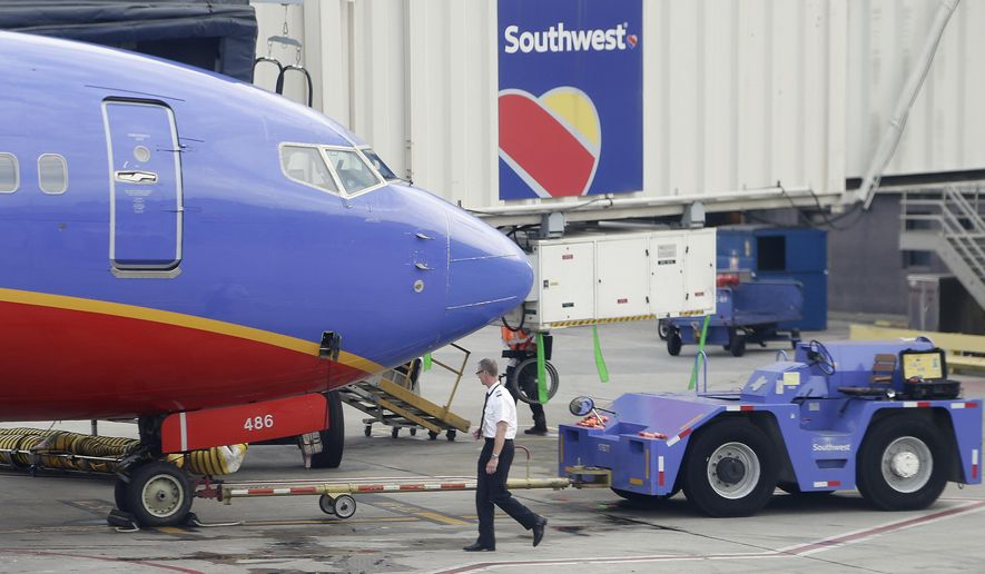 Southwest announced on Twitter Tuesday evening that every person who started working for Southwest Airlines prior to Dec. 31, 2017, will soon receive a $1,000 cash bonus on Jan. 8, 2018. (Associated Press)