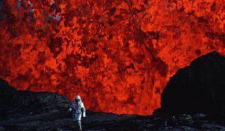 "This image released by Netflix shows a scene from the documentary, ""Into the Inferno,"" written and directed by Werner Herzog. The film explores active volcanoes around the world. (Netflix via AP)"