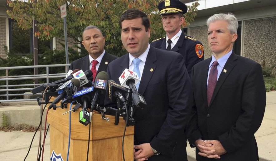 Suffolk County Police Commissioner Timothy Sini, at podium, speaks at a news conference in front of a Suffolk County police precinct in Bay Shore, N.Y., on Oct. 24, 2016, about a rash of slayings in nearby Brentwood, N.Y. From left are New York State Assemblyman Phil Ramos, D-Brentwood, Suffolk County Police Chief of Department Stuart Cameron and Suffolk County Executive Steve Bellone. (AP Photo/Michael Balsamo)