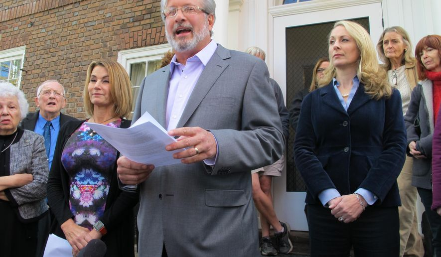 Connecticut state legislative candidate Dr. William Petit, flanked by state House Minority Leader Themis Klarides, R-Derby, left, and his wife, Christine, right, speaks to the media, Wednesday, Oct. 26, 2016, outside his home in Plainville, Conn. about a political advertisement linking him to Donald Trump and attacks on women and families. Petit's first wife and two daughters were killed in an infamous 2007 home invasion. (AP Photo/Pat Eaton-Robb)