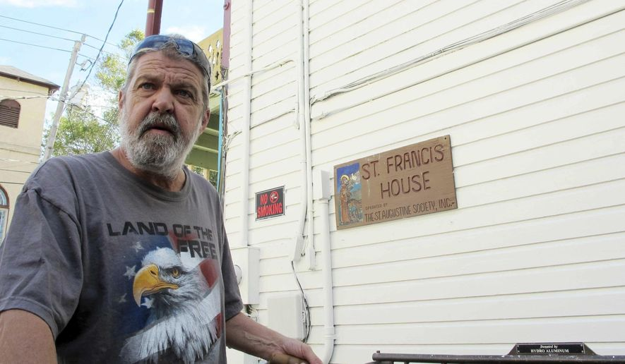 In this Oct. 24, 2016 photo, Bob Veeder, 58, stands outside St. Francis House in St. Augustine, Fla. Veeder, who is homeless, has been sleeping on the street since Hurricane Matthew damaged the only full-time homeless shelter in St. Johns County. The storm eliminated nearly a third of the county's homeless shelter capacity. (AP Photo/Jason H. Dearen)