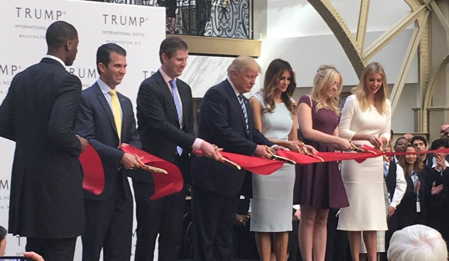 GOP presidential nominee Donald Trump and family members cut the red ribbon at the opening ceremony of the Trump International Hotel in Washington, D.C., on Oct. 26, 2016. (Eric Althoff/The Washington Times) ** FILE **