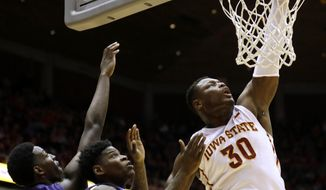 FILE - In this Feb. 20, 2016, file photo, Iowa State guard Deonte Burton (30) dunks the ball over TCU's JD Miller, left, and Chauncey Collins, center, during the first half of an NCAA college basketball game, in Ames, Iowa. (AP Photo/Charlie Neibergall)