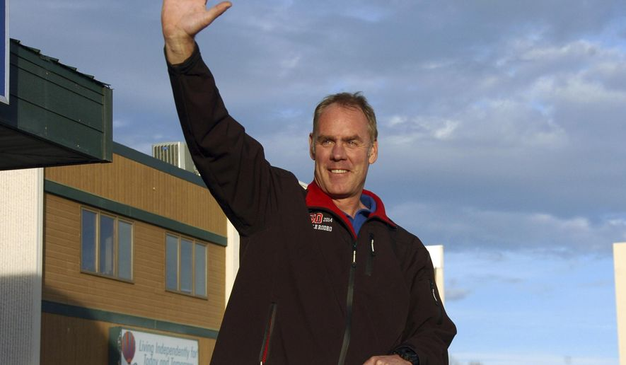 This Oct. 20, 2016 photograph shows Montana Republican U.S. Rep. Ryan Zinke waving to passing traffic in Billings, Mont., as he campaigns for re-election to a second term as the state's sole representative in the U.S. House. Zinke's being challenged in the Nov. 8 election by state Superintendent of Public Instruction Denise Juneau. (AP Photo/Matthew Brown)