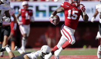 FILE - in this Sept. 17, 2016, file photo, Nebraska wide receiver De'Mornay Pierson-El (15) runs past a tackle attempt by Oregon defensive back Jaren Zadlo (38) during the first half of an NCAA college football game in Lincoln, Neb. Nebraska's dynamic return man and receiver, is looking more like his old self since coming back from a devastating knee injury. The Cornhuskers would love for him to have a breakout game this week against Wisconsin. (AP Photo/Nati Harnik, File)