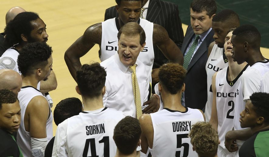 FILE - In this Feb. 7, 2016, file photo, Oregon coach Dana Altman, center, talks with his team during an NCAA college basketball game against Utah in Eugene, Ore. The Ducks look to build on their remarkable success from last season. (AP Photo/Chris Pietsch, File)