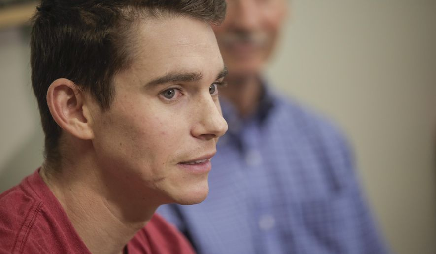 Joseph Tanner, who survived a shark bite while surfing on the Oregon Coast on Oct. 10, 2016, speaks with the media at Legacy Emanuel Medical Center in Portland, Ore., where he is a critical care nurse, Wednesday, Oct. 26, 2016. (Stephanie Yao Long/The Oregonian via AP)