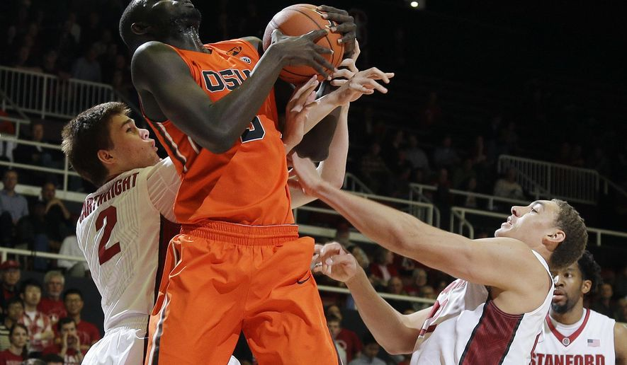 FILE _ In this Feb. 26, 2016, file photo, Oregon State center Cheikh N'diaye, center, grabs a rebound next to Stanford guard Robert Cartwright, left, and forward Reid Travis during the first half of an NCAA college basketball game in Stanford, Calif. With mostly freshman and sophomores on their roster, the Oregon State Beavers are laying a foundation for the future. There's only one senior, N'diaye, who is coming off shoulder surgery, on the roster. (AP Photo/Marcio Jose Sanchez, file)