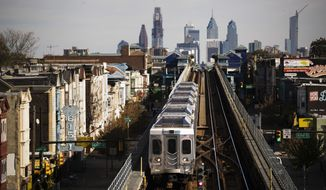 A train moves along the Market-Frankford Line in Philadelphia, Wednesday, Oct. 26, 2016. (AP Photo/Matt Rourke)