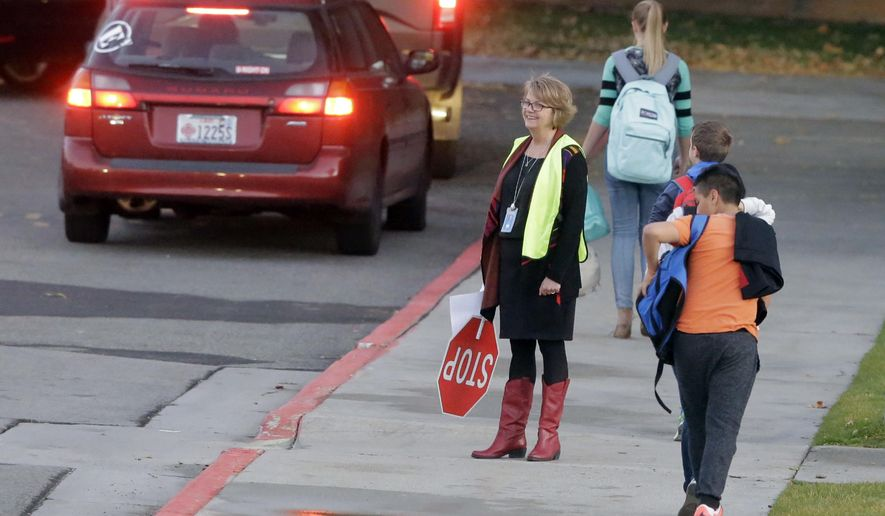 Students arrive at Union Middle School, Wednesday, Oct. 26, 2016, in Sandy, Utah. Dozens of students at the middle school in a Salt Lake City suburb witnessed a shooting Tuesday, Oct. 25, in which a 16-year-old boy was critically wounded by another teenager during an argument, police said. Police arrested a 14-year-old who they believe was the shooter. The victim was taken by ambulance to a hospital and is in critical condition. (AP Photo/Rick Bowmer)