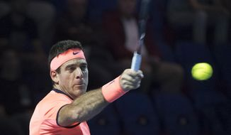 Argentina's Juan Martin Del Potro returns a ball to Robin Haase of the Netherlands during their first round match at the Swiss indoor tennis tournament at the St. Jakobshalle in Basel, Switzerland, on Wednesday, Oct. 26, 2016. (Georgios Kefalas/Keystone via AP)