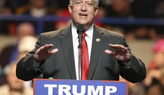 FILE - In this May 5, 2016 file photo, West Virginia Senate president, Sen. Bill Cole, and gubernatorial candidate gestures during a rally for Republican Presidential candidate Donald Trump during a rally in Charleston, W.Va. Cole says ending straight-ticket voting in West Virginia was the right thing to do, even if it costs him the full benefit of GOP presidential nominee Donald Trump's coattails. Cole faces Democrat Jim Justice in the general election. (AP Photo/Steve Helber, File)