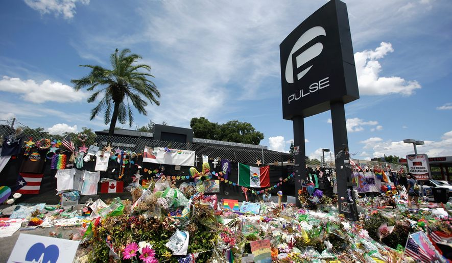 The Women for Trump tour made an unscheduled stop at the Pulse Nightclub memorial in Orlando, Florida, on Thursday to pay their respects to the shooting victims. (Associated Press)
